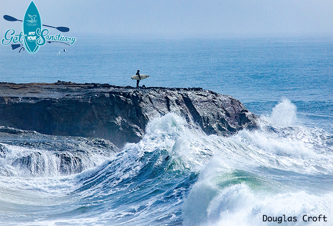 image of a surfer contemplating the swell at Lighthouse Point in MBNMS