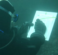 diver with writing slate