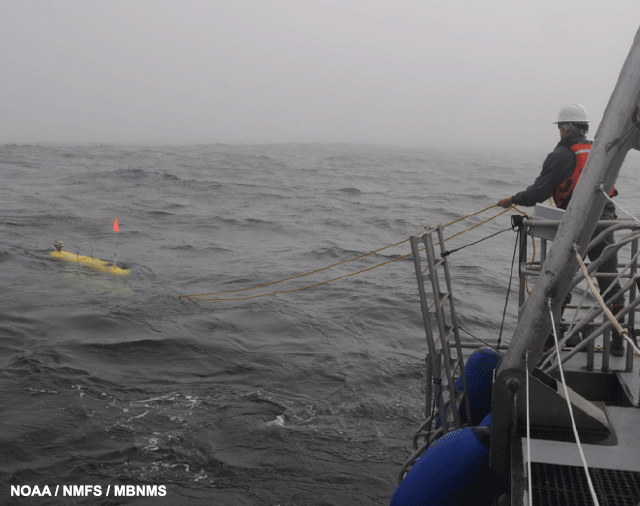 image of AUV being deployed from the R/V Fulmar at outer Carmel Canyon.