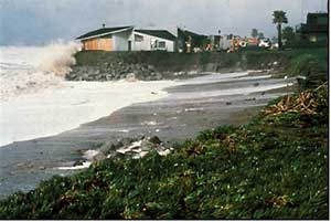 ocean front home being hit by wave